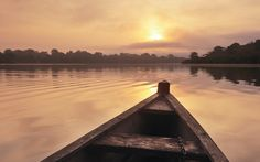 20 great things to do as the sun rises - Take a boat along the Ganges, Varanasi, India Glide through the sacred waters as India's holiest and oldest city eases itself into the new day. Bathed in an orange glow, the flights of stone ghats that … Bolivia, Amazon River, Travel Images, Travel Information, Nice View, Canoe, South America, Travel Inspiration, Photo Galleries