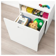 STUVA / FRITIDS Toy storage with wheels, white, white, cm. A spacious toy box on wheels and a shelf for books are hidden behind the front. If you need even more storage, you can also add other frames from the STUVA series. Smart Storage, Toy Storage, Ikea Stuva, Kids Dressers, Honeycomb Paper, Ikea Family, Tidy Up, Drawer Fronts, Homemade Home Decor