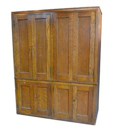 Large built-in oak cabinet from a school, once used for storing a variety of supplies. Each cupboard locks and has multiple shelves inside.