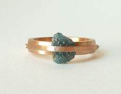 Rose gold natural rough blue diamond engagement ring. Love the raw edge of the diamond with the clean lines of the rose gold.