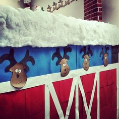 Cute reindeer stable!  Easy to make reindeer heads with cutouts.  Stable doors made with office paper and red construction paper.  Easy office decorating for holidays and Christmas.  Santa's workshop & North Pole Hear Me Roar! - thecarbmonster: Oh Deer! Christmas Cubicle/Office Decorating