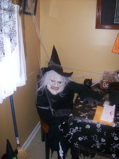 Easy Halloween decor.  Stuff the shirt with pillows and cover with witch robe.  Stuff the mask and sit it in a chair for an unwelcome visitor at your party