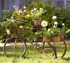 wonderful display of flower baskets on rusty vintage bicycle