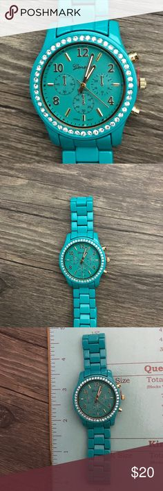 Teal Watch with Rhinestones adjustable band NWOT Teal watch with rhinestones around face and gold numbers. This watch is NWOT. It can be adjusted. Jewelry Bracelets