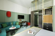 Patricia Urquiola designs a colorful Hotel Room Mate Giulia in Milan | You can visit us at our website, http://www.essentialhome.eu and check our Pinterest @midcenturyblog to get more #MidCenturyModern inspiration.