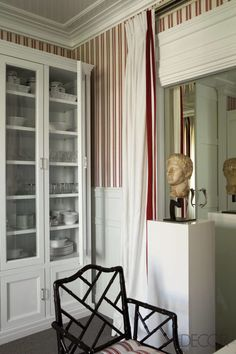 "Similar juxtapositions of vintage and vanguard occur throughout the home, where 1st-century Roman busts stand before bold abstract artworks by such 20th-century Spanish masters as Miró, Chillida, and Millares. ""From Praxiteles to Pollock—it's all a continuum to me,"" Bustamante says, adding that he feels equally inspired at New York's Museum of Modern Art as at the Louvre. In his bedroom, Bustamante accentuates nautical connotations with large vintage photographs of racing yachts adorning…"