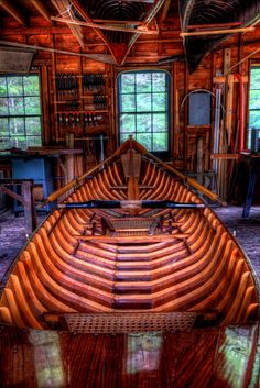 Lets go into the boathouse. The boatbuilder showed up at the Boathouse at Great Camp Sagamore near Racquette Lake, NY. The wide doors opened with natural light coming through the doors and window…