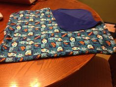 PRICE: $25.00. FLANNEL BLANKET. OLAF WITH BLUE BACKING SOFT FLANNEL 24IN  X 40IN MADE BY KRIS