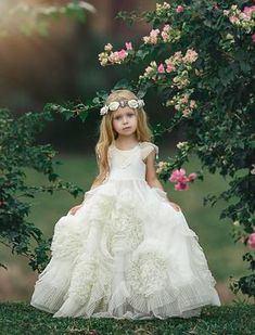 A delightfully captivating frock with a soft flowing tulle skirt covered in pleated swirls. An embellished pearl and silver beading applique sits over each shou Girls Dress Up, Little Girl Dresses, Flower Girl Dresses, Couture Wedding Gowns, Dream Wedding Dresses, Beautiful Frocks, Bridesmaid Duties, Fantasy Gowns, Cute Little Girls