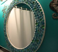 Love this mirror with glass vase filler beads glued on.