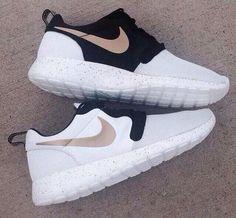 Nikes black white & gold
