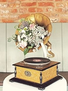 Vintage wedding vase --an old Victrola record player! This wedding has several innovative decor ideas.