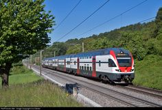 Four car double deck trainset 511 110, built by Stadler Rail, on the way from Basel to Zürich-Airport.