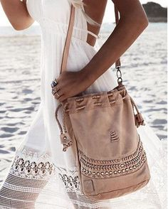 Perfection in our dreamy Tribal Child drawstring leather shoulder bag in sea sand. We are loving how Gypsy Loving Light is wearing this purse with lace and lots of stunning boho style jewelry. The bag comes in 5 different colors.