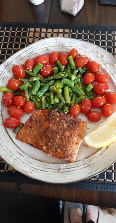 Pan fry salmon with skin on. Use Club House salmon spice on flesh side only   In a separate pan add: 1 batch chopped asparagus 3 cloves chopped garlic handful of sesame seeds salt and pepper to taste 1 pint small cherry tomatoes  Cook until tender and serve with salmon