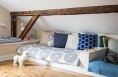 Alicia and Daniel carved a kids' room out of the attic space, installing built-in beds and a desk.