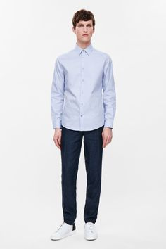 This slim-fit shirt is made from soft cotton poplin with a fine checked pattern. A versatile style with neat proportions, it has a classic collar, subtly curved hem and a clean front button fastening.