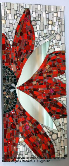 """Sometimes a Butterfly"":  Materials for this mirror/wall-hanging include a hand cut variety of glass like stained glass, vitreous, iridium, hand-made fused glass by the Artist, milifiori, rhinestones, pearls, and Swarovski crystals."