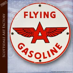 Flying A Gasoline sign gas pump advertising signage. Vintage 1950s Americana. Original, not restored, not reproduction old gas signs. 10-inch diameter porcelain one-sided red, white and black FLYING A GASOLINE by Associated Oil Company