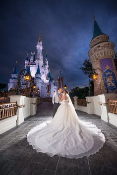 what a dress wedding portrait session at the magic kingdom in front of cinderella castle photo wedding pictures Disney Wedding Castle Fairy Tales Disney World Wedding, Disney Inspired Wedding, Disney Wedding Dresses, Princess Wedding Dresses, Walt Disney World, Disney Weddings, Tangled Wedding, Cinderella Wedding, Fairytale Weddings