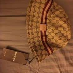 Authentic Gucci unisex hat This beautiful unisex Gucci hat it's perfect for both men and women when wanting to cover your head out and about under the sun. Item comes with original tags and on sale for $139. NEVER WORN Gucci Accessories Hats