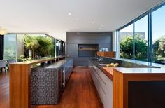 The kitchen is narrow but long with spacious counters, including a gorgeous butcher block.