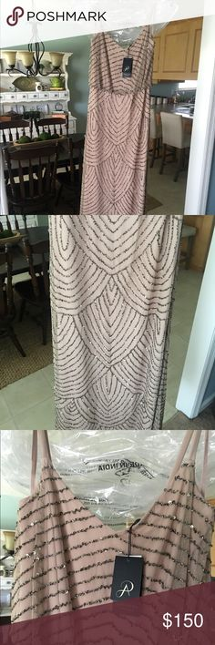 Adrianna Papell designer gown. Never worn. New with tags. Bought for wedding. Decided on a different dress. This would make a great mother of the bride/groom dress, bridesmaid/ maid of honor dress, or even for a formal dinner, event  or ball. Size vary slightly. Can fit between a 8-12 Adrianna Papell Dresses Wedding
