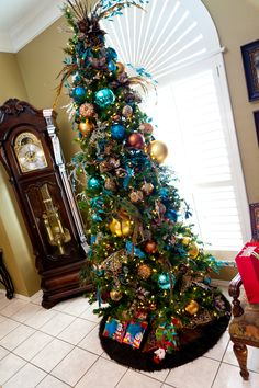 """Peacock Gone Wild"" narrow Christmas tree, perfect for a living room! how to? http://www.app.showmedecorating.com"