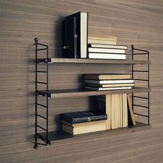 String Pocket is a compact and elegant shelf for books, collectables and other small items. Launched in 2005 by the Swedish manufacturer String, String Pocket is part of the popular collection designed by Nils Strinning in String Pocket, Wooden Shelving Units, Modular Shelving, Storage Shelving, Shelving Systems, Vintage Furniture, Furniture Design, Office Furniture, String Regal
