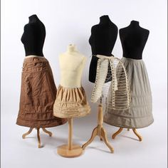 Bonhams. A group of crinolines and bustles, To include a small childs example, a wire-work bustle, a striped cotton bustle back and a circular striped example.