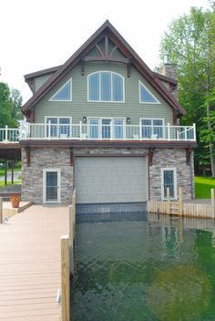 Exterior photo of a douglas fir Woodhouse timber frame boathouse and home