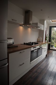 We specialise in manufacturing bespoke solid hardwood worktops. Made from wide planks or single staves of Iroko, Maple, Oak, Walnut, Ash & Cherry. Walnut Worktops, Wide Plank, Work Tops, Kitchen Ideas, Hardwood, Kitchen Cabinets, Home Decor, Natural Wood, Decoration Home