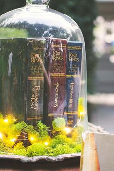 17 Non Floral Centerpieces That Will Make You Forget About The Flowers Any bibliophile will love these old leather book centerpieces at their wedding reception tables! Book Wedding Centerpieces, Non Floral Centerpieces, Wedding Reception Tables, Wedding Decorations, Centerpiece Ideas, Reception Games, Hobbit Wedding, Hobbit Party, Dream Wedding