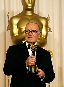 HOLLYWOOD - FEBRUARY 25: Composer Ennio Morricone poses with his Honorary award in the press room during the 79th Annual Academy Awards at the Kodak Theatre on February 25, 2007 in Hollywood, California. (Photo by Vince Bucci/Getty Images)