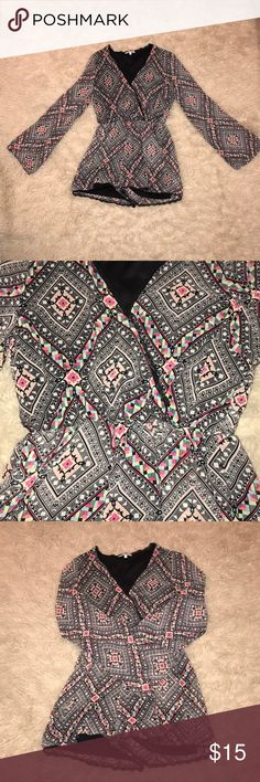 Tribal print romper Charlotte Russe tribal print romper with a deep v-neck and elastic waist band. Only worn twice and is in great condition as it has been professionally dry cleaned Charlotte Russe Other