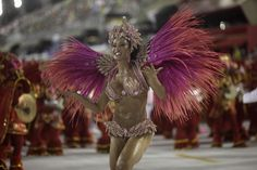 Drum queen Gracyanne Barbosa from the Jacarezinho samba school prepares to dance during the first night of the A Group annual Carnival parade in Rio de Janeiro's Sambadrome February 8, 2013. The Samba School which wins the A Group will parade with the top samba groups at the Special Group performance in 2014. REUTERS/ Ricardo Moraes (BRAZIL - Tags: SOCIETY)
