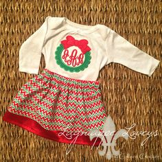 Christmas wreath onesie with red and green chevron and satin skirt for baby and toddler by Lagniappe Loveys on Facebook http://www.facebook.com/lagniappeloveys #embroidery