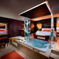 Hard Rock Hotel and Casino in Punta Cana, Dominican Republic.-  Can't wait to be in a room just like this!!!  :)