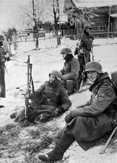 German Wehrmacht soldiers pause en route to the Battle of Moscow. Temperatures drop to as low as -40°C and the Germans are ill-equipped for the Russian winter, with jackets made of light wool and leather boots with no insulation. However, the battle would be costly to the Soviets as well; between 650,000 and 1,280,000 Soviet casualties and losses would occur before the Axis were repelled. Moscow Oblast, Russia, Soviet Union. December 1941.