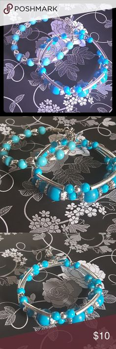 Lovely Turquoise Bead Bracelets Two turquoise colored bead bracelets. New. One wraps around wrist other hooks. Wrap around fits any size wrist. Other fits up to 7 inch wrist. Jewelry Bracelets