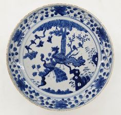 Lot 183- Antique Chinese Ming Style Blue & White Porcelain Phoenix Bowl 2.5''x11.5''. Depicts a phoenix and peacock bird landscape in blue underglaze with scrolling lotus flower border. Scattered glaze edge roughness to rim, otherwise excellent condition. Kangxi period copy of Ming dynasty piece. 18th century, Qing dynasty.