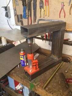 Dimple Die and Press by Steinbruchsoldat -- Homemade dimple die and press set constructed from round steel stock and rectangular tubing. Powered by a bottle jack. http://www.homemadetools.net/homemade-dimple-die-and-press