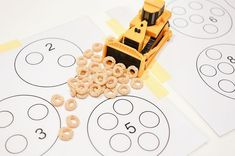 Counting with bulldozer and cheerios. Construction theme activity to learn counting
