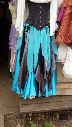 From the renaissance festival!! Petal skirts! There are about 4 layers. A blue chiffon short petal skirt (they braided a couple top pieces with a couple of the underneath pieces), a long silver and black lace petal skirt, a long blue silky skirt and the white dress underneath.