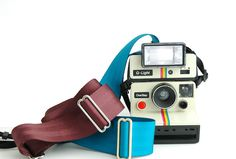 Seat Belt Camera Straps - Hand made with seat belts pulled straight from benches! ($20.00, http://photojojo.com/store)