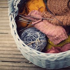 A peek into a knitting basket filled with beautiful natural and hand-dyed yarns.