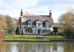 Russell Brand plans pool and cinema for his £3.3million thatched cottage | Daily Mail Online