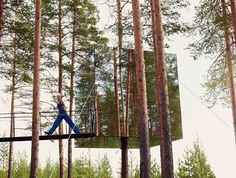 Up in the Air - Karlie Kloss steps out from the Mirrorcube, one of six whimsical rooms suspended in the forest at the Treehotel in Swedish Lapland.Fashion Editor: Phyllis Posnick