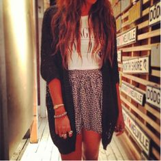 Black crochet dolman cardigan, white graphic tee tucked into a ditsy print skirt