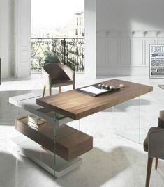 El mueble escritorio en madera chapada en nogal con los laterales en cristal templado, y 2 estantes de Dm lacado y 1 de madera de nogal.